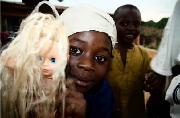 African girl, white blonde doll.